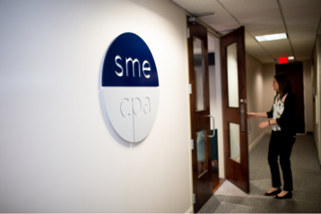 An image of a girl walking into an office at SME tax accounting in Augusta GA.